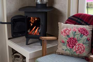 The cosy little wood-burner will add warmth and cosiness on cooler days.
