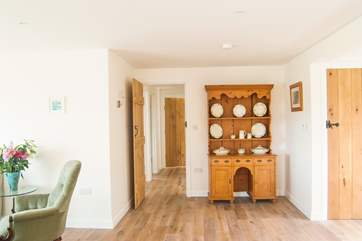 The bedroom corridor leads off from the open plan living-room.