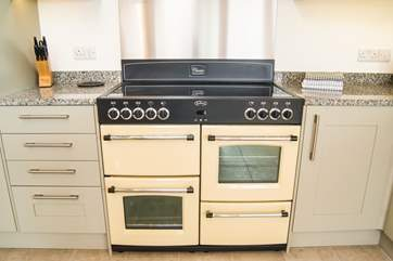 A lovely big electric range cooker in the kitchen area.