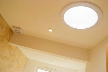 Both bathrooms have clever light tubes for additional light.