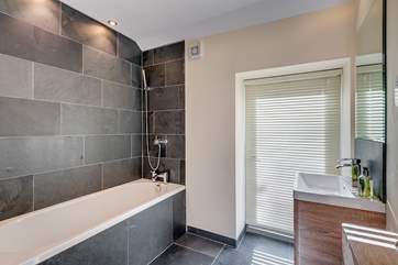 Light pours in to this gorgeous en-suite bathroom (Bedroom 1).