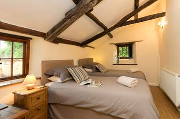 This twin bedroom is on the ground floor of the farmhouse. There is a little cloakroom right next door, off the kitchen.
