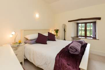 This is the second double bedroom on the first floor, with views out over the front garden of the farmhouse.