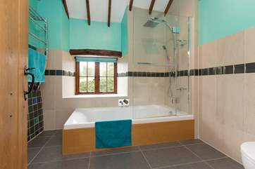 The family bathroom on the first floor is bright and cheerful with its sunken bath.
