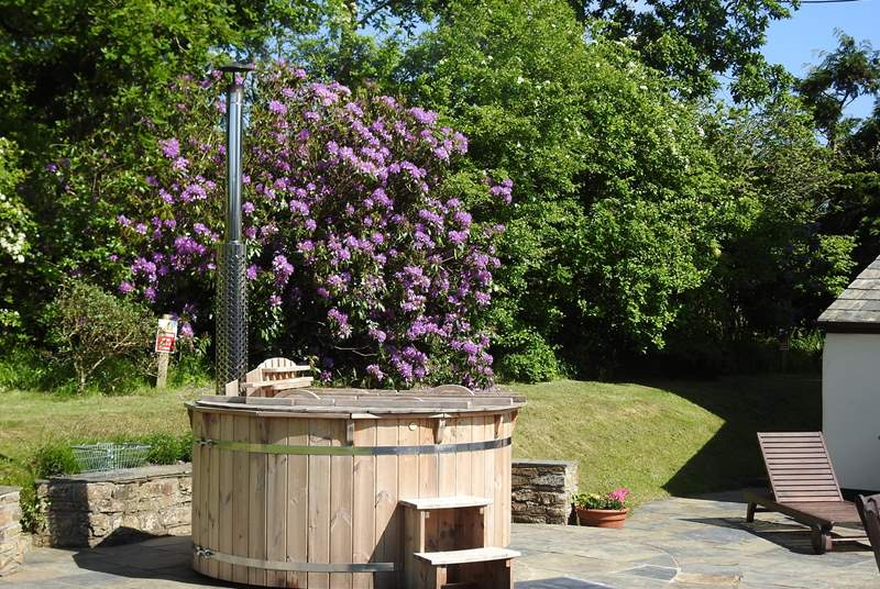 The wood-fired hot tub is in the very private rear garden. What a treat and what a lovely setting for a soak under the stars!