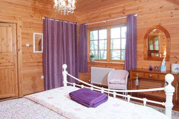 In the corner of the master bedroom there is a dressing room/cot room.