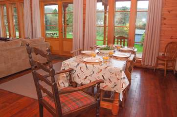 There is a lovely farmhouse dining table with plent of room for all.