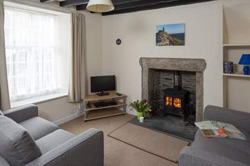 The cosy sitting-area with the wood-burner glowing.