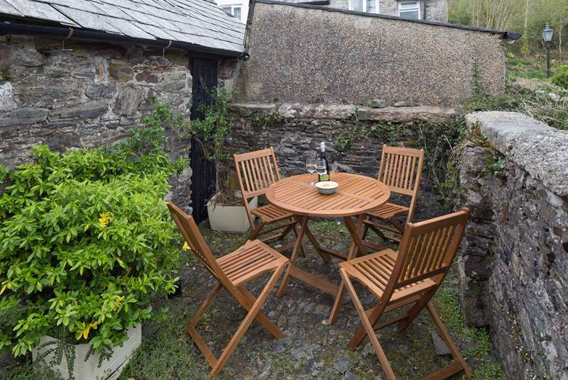 The patio behind the cottage. Perfect for a spot of breakfast in the sun, or a glass of wine in the evening.