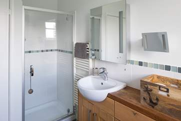 The shower-rooms also provides a utility-area.