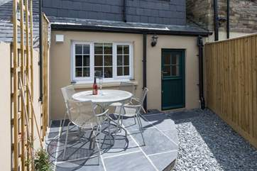 The sunny sheltered patio at the rear of the cottage.