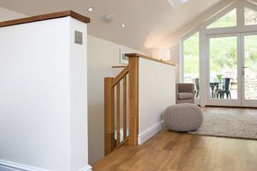 The stairs lead down from the living area to the bedrooms and bathroom.