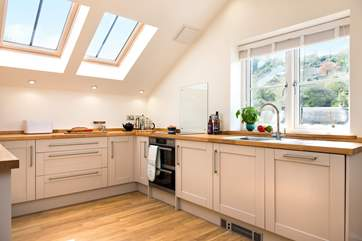 The stylishly fitted kitchen is very well-equipped and has wonderful views.