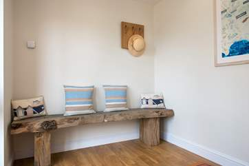 A lovely wooden bench in the hallway.