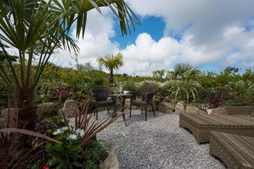 With its fabulous sheltered 'tropical' patio-area.