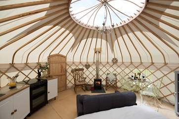The main yurt has a fully fitted kitchen (including oven and fridge) a wood-burner, dining-area and the lovely king-size bed.