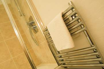 A heated towel rail to keep towels cosy.