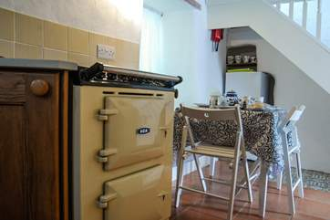 This Aga electric cooker sits happily in the ancient cottage.
