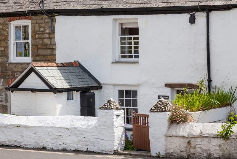 Mapled Cottage is located in a terrace of cottages, and overlooks a road. There are two steps leading down to the property.