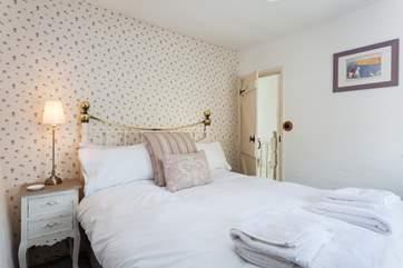The pretty master bedroom.