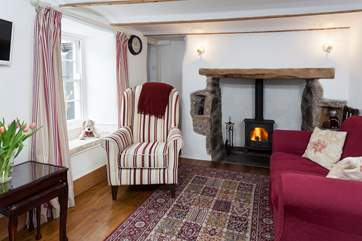 The lounge is the perfect place to relax with the comfy sofas and roaring wood burner.