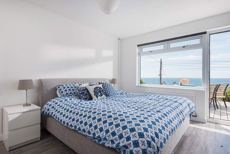 The fabulous master bedroom is located on the lower ground floor and has a door out onto the garden decking.