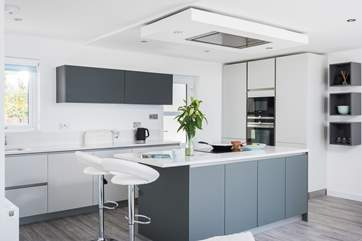 The stylishly cool and funky kitchen where you can change the colour of the lights above the island to suit your mood.