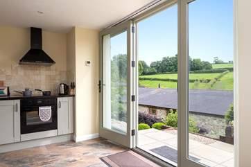 The kitchen shares the same wonderful valley views. Purtington Barn Cottage is below the Studio and so you will feel totally independent and private.
