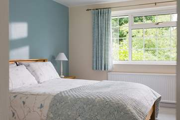This bedroom is light and spacious and decorated in calm colours.