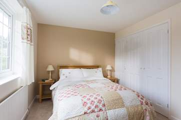 Bedroom 2 is also at the front of the house and is furnished with a double bed.