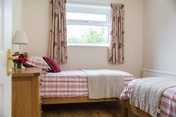 The twin bedroom is furnished with two 3ft single beds.