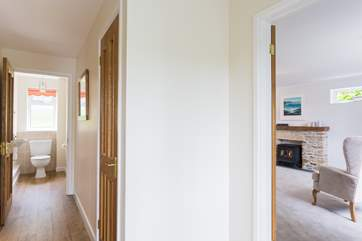The entrance hallway with the sitting-room to your right, the kitchen/diner to your left and a downstairs loo straight ahead.