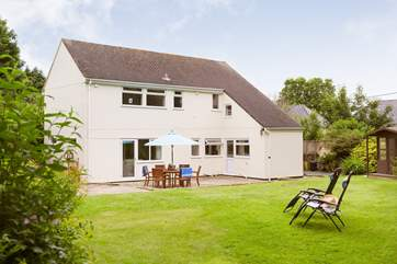 The back garden is large enough for relaxing, al fresco dining or playing games.