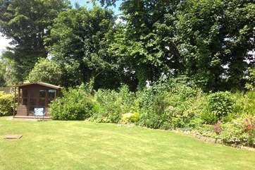The pretty back garden is a tranquil and private place with plenty of room to run around.