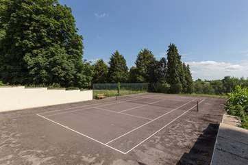 This cottage, and Orchard Barn next door, also have this shared tennis court to enjoy.