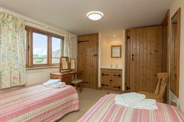 Another view of the twin bedroom which offers plenty of space for adults or children.