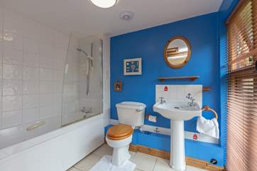 This cheerful family bathroom is on the ground floor.