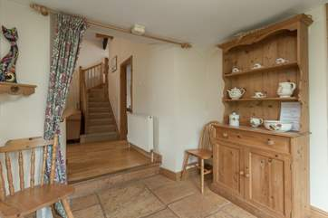 There is a lovely entrance hallway for the cottage. The doorway at the foot of the stairs is for the twin bedroom.