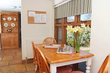 There is a bright and cheerful kitchen off the entrance hall