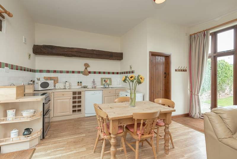 The cottage has a light and bright kitchen/dining area - the living space is all open plan with French windows to the garden.