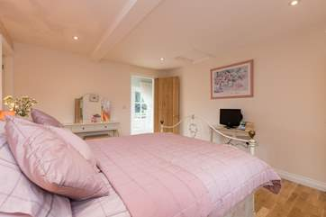 Another view of this bedroom. The en suite bathroom is just off to the left of this picture.