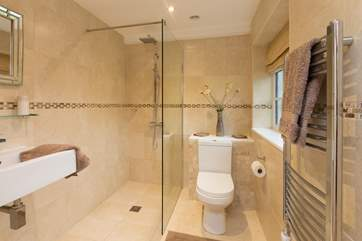 This bedroom has a spacious wet-room style shower.