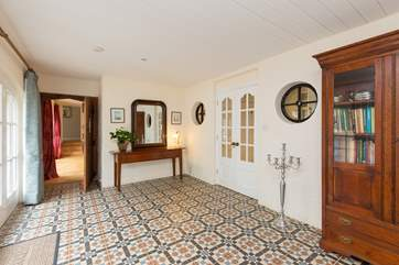 This beautiful tiled entrance hall sets the scene for a very comfortable stay at The Coach House Stables. A coat stand and boot rack is provided.