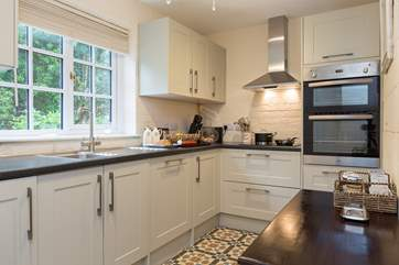 The well-equipped kitchen has all that you will need during your holiday here. The dining area also has a large dresser with even more items provided to make your stay a wonderful one.