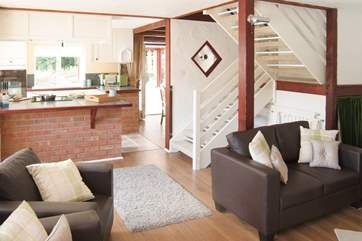 Open plan living on the ground floor and stairs up to the two bedrooms and bathroom.