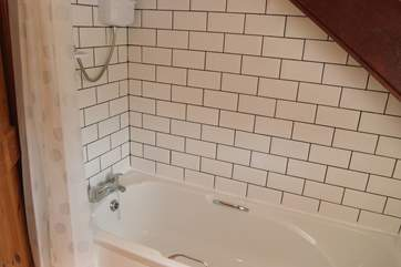 The recently fitted family bathroom sits between the two bedrooms on the first floor.