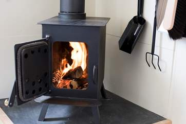 This cosy little wood-burner will keep you very warm and toasy.