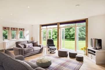 Two sets of French doors open onto the garden from the spacious sitting-room.