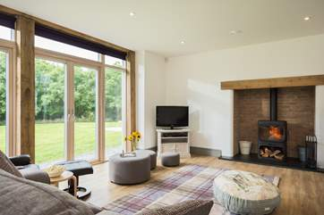 A cosy and funky wood-burner sits in the impressive inglenook fireplace, although you wont need it for heat in this highly insulated eco-house.