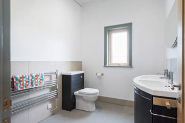 This fabulous en suite has not one but two wash-basins!